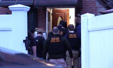 HHS OIG federal agents entering a home through the front door