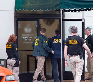 HHS and FBI agents walk into a business